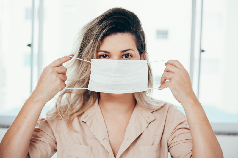Cosmetic Solutions Covid Webinar Image features a female holding a mask over her face