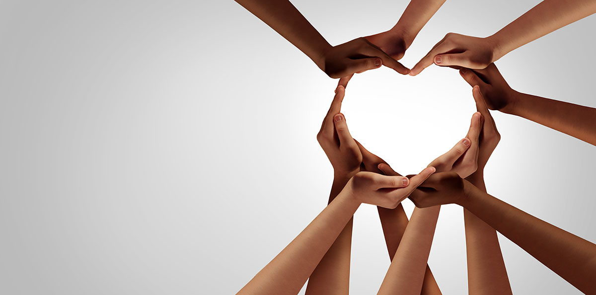 Private Label Skincare Manufacturer Diversity Statement Image featuring hands of people of all races coming together