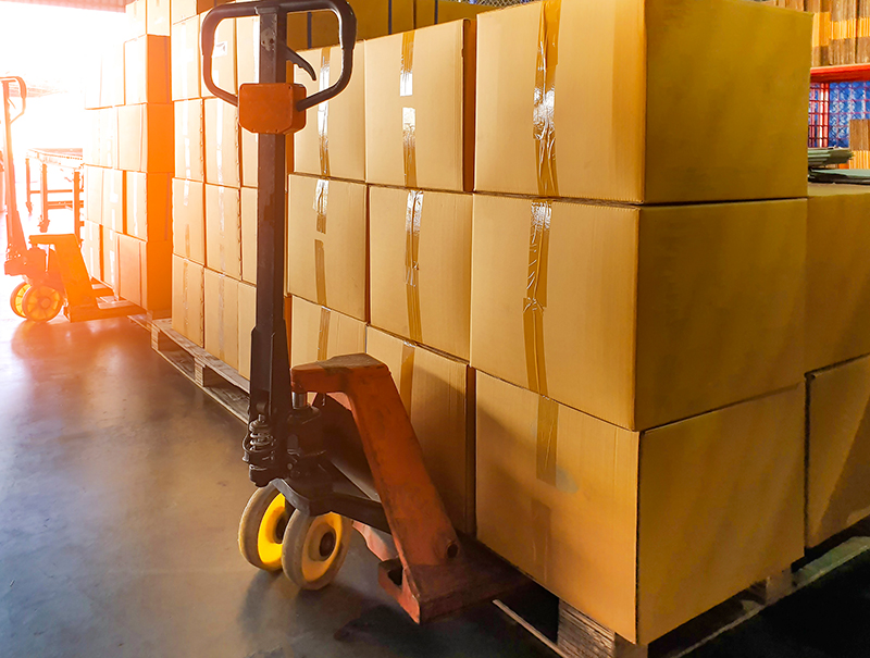 Shipping image featuring shipping pallets and a pallet jack