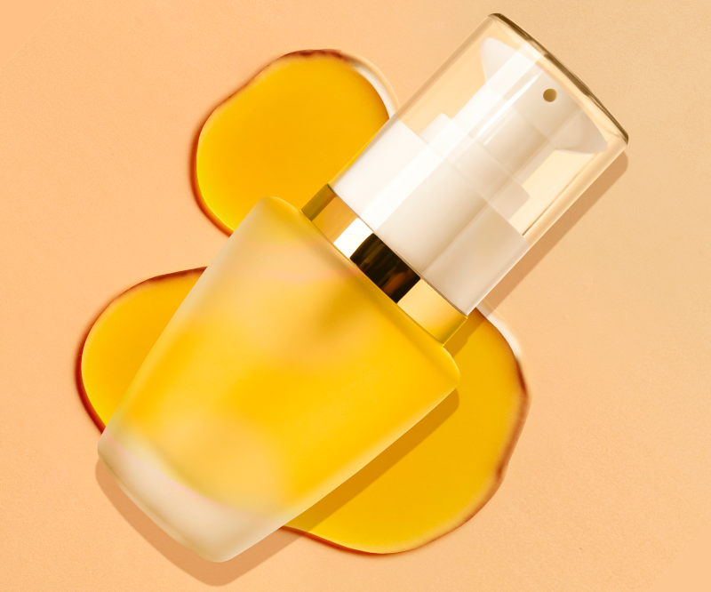 Turnkey Image features a skin care thames airless container with skin care formula against a yellow background
